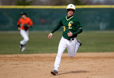 Sarah Nader - snader@shawmedia.com Crystal Lake South's Ryan Hetherington runs to third during Tuesday's game in Crystal Lake against Crystal Lake Central. Crystal Lake South won, 8-0.