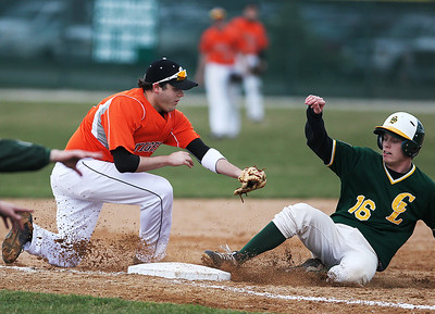Sarah Nader - snader@shawmedia.com Crystal Lake Central's Tanner Larkins (left) is slow to tag out Crystal Lake South's Tommy Gaede as he safely slides to third during the fourth inning of Tuesday's game in Crystal Lake on April 16, 2013.