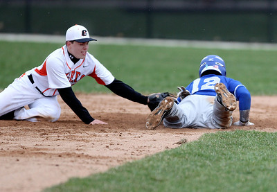 Sarah Nader - snader@shawmedia.com Crystal Lake Central's Nathan Klyczek dives to tag out Woodstock's Eric Bell as he slides back into second base during the third inning of Friday's game in Crystal Lake on April 19, 2013. Crystal Lake Central won, 12-2.