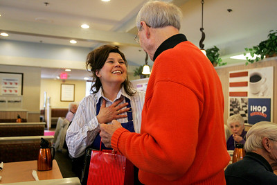 Monica Maschak - mmaschak@shawmedia.com IHOP waitress Christine Schaefer gets excited after peeking at a gift Bob Robinson, a 1950 Crystal Lake Community High School alum, brought for the alumnus group founder Russ Nolte. About 30 alumnus gathered at the McHenry IHOP on Thursday, April 11, 2013 to celebrate their 100th lunch-time meeting since 2004. Shaefer has been the same waitress for the group since their first meeting.