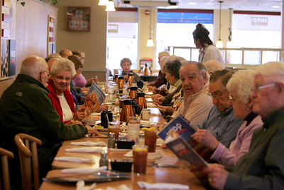 Monica Maschak - mmaschak@shawmedia.com About 30 Crystal Lake Community High School alumnus from the early 1950s celebrate 100 monthly meetings at IHOP in McHenry on Thursday, April 11, 2013. The group, started by Russ Nolte, has been meeting on the second Thursday of every month for more than eight years.
