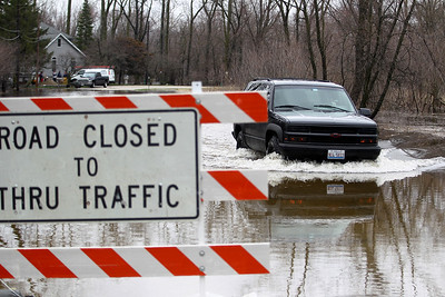 Sarah Nader - snader@shawmedia.com W Riverside Drive in McHenry was closed after Fox River flood waters covered the road on Thursday, April 19, 2013.