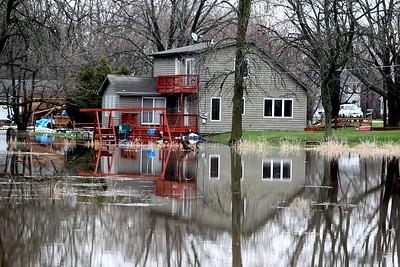 Sarah Nader - snader@shawmedia.com Floods reach the back of a home in McHenry on Thursday, April 19, 2013.
