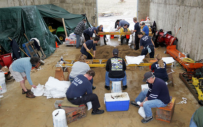 Monica Maschak - mmaschak@shawmedia.com Volunteers work to fill bags with sand at the Fox Lake Street Department to distribute to those in the area who may need them on Thursday, April 18, 2013. Water levels are encroaching on many homes in the area after heavy rainfall. An estimated more than 12,000 bags have been filled by these volunteers.