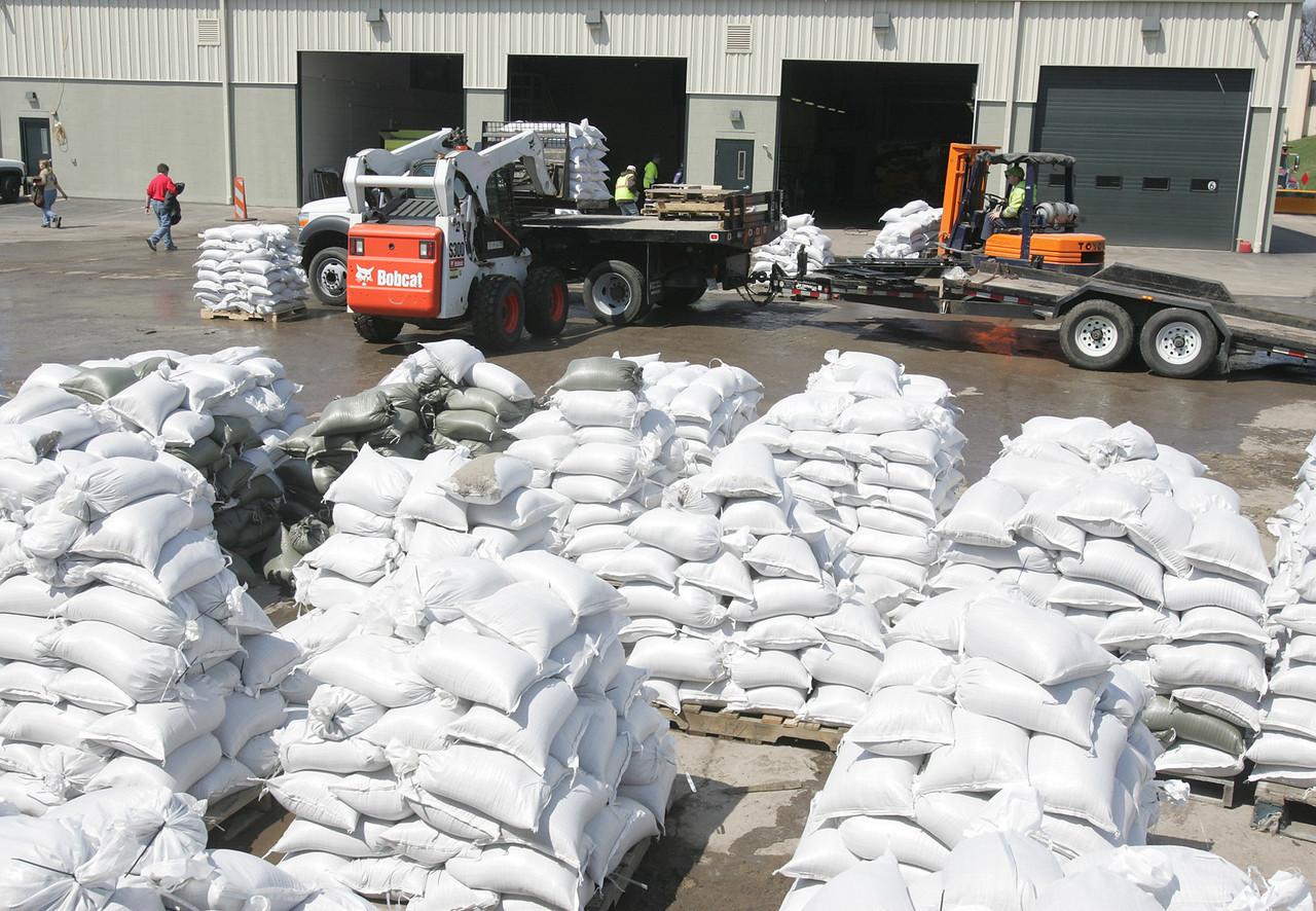 H. Rick Bamman - hbamman@shawmedia.com  Nunda Township employees load sandbags at the highway department's garage on Bay Rd. Hundreds of volunteers spent the last four days filling sandbags.