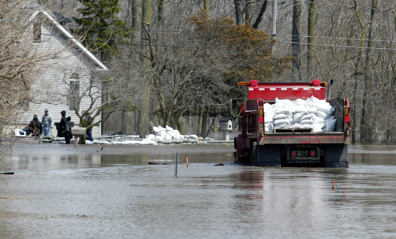H. Rick Bamman - hbamman@shawmedia.com  A Nunda Township truck loaded with sandbags makes a delivery to a home in Orchard Heights.