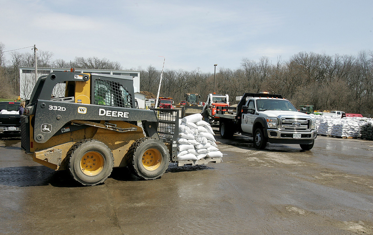 H. Rick Bamman - hbamman@shawmedia.com  A Nunda Township employee uses a skid loader to move sandbags for deleivery at the highway department garage.