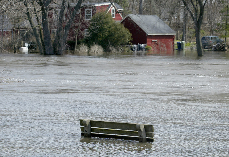 H. Rick Bamman - hbamman@shawmedia.com  A submerged bench in a yard on Center St. in Algonquin measures the Fox River flooding water level.