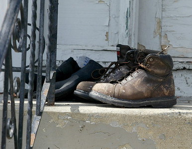 H. Rick Bamman - hbamman@shawmedia.com  Gloves and boots dry in the Sunday morning sun on the steps of a home on Center St. in Algonquin
