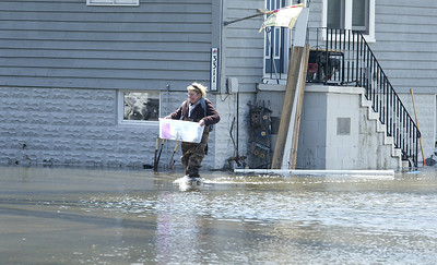 H. Rick Bamman - hbamman@shawmedia.com  Holiday Hills homeowner Kris Drexler moves belongings to her car on S. Riverdale Rd. Sunday afternoon. Drexler was hoping to stay in her home overnight to watch her sump pumps. Other neighbors had already left their home.
