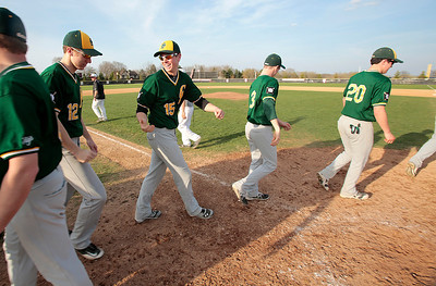 Kyle Grillot - kgrillot@shawmedia.com   Crystal Lake South senior Mike House (15) laughs with teammates after the game at Prairie Ridge high school on Tuesday, April 30, 2013. Crystal Lake South won the game 13-2.