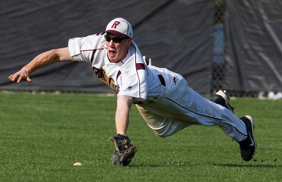 Kyle Grillot - kgrillot@shawmedia.com   Prairie Ridge senior Bryan Klendworth dives for a ball in the outfield during the game against Crystal Lake South at Prairie Ridge high school on Tuesday, April 30, 2013. Crystal Lake South won the game 13-2.