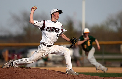 Kyle Grillot - kgrillot@shawmedia.com   Prairie Ridge senior Drew Buchta pitches the ball during the game against Crystal Lake South at Prairie Ridge high school on Tuesday, April 30, 2013. Crystal Lake South won the game 13-2.