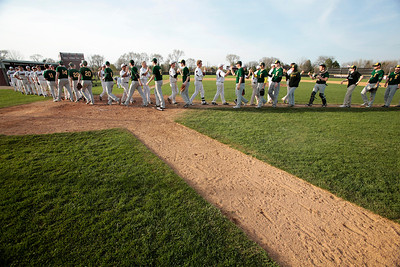 Kyle Grillot - kgrillot@shawmedia.com   Teams greet each other after the close of the game the game against Crystal Lake South at Prairie Ridge high school on Tuesday, April 30, 2013. Crystal Lake South won the game 13-2.