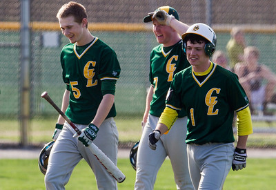 Kyle Grillot - kgrillot@shawmedia.com   Crystal Lake South sophomore Garrett Bright (5) is greeted by his teammates after he hit a home run during the game at Prairie Ridge high school on Tuesday, April 30, 2013. Crystal Lake South won the game 13-2.
