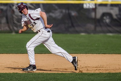 Kyle Grillot - kgrillot@shawmedia.com   Prairie Ridge senior Bryan Klendworth runs the bases during the game against Crystal Lake South at Prairie Ridge high school on Tuesday, April 30, 2013. Crystal Lake South won the game 13-2.