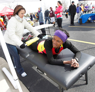 Candace H. Johnson Ashley Reed, a physical therapist with McHenry County Physical Therapy, uses a foam roller on Karen Sersen, of Cary, to relax her muscles while she waits for the results after The Human Race, a 5K walk/run supporting McHenry County charities on Corporate Drive in McHenry. Sersen came in second place in the Female 50-54 division.