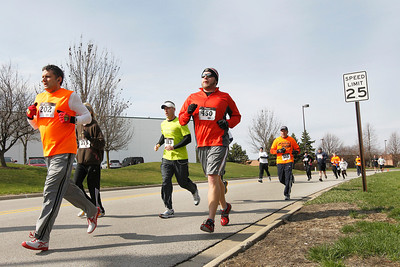 Candace H. Johnson Runners keep their pace during The Human Race, a 5K walk/run supporting McHenry County charities on Prime Parkway in McHenry.