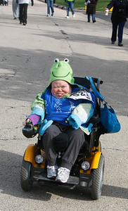 Candace H. Johnson Stefanie Sullivan, 30, of McHenry travels in her motorized wheelchair during The Human Race, a 5K walk/run supporting McHenry County charities on Corporate Drive in McHenry. Sullivan was participating in the race for Options & Advocacy in Crystal Lake.