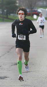 Candace H. Johnson Christopher Rodriguez, 25, of Oakwood Hills, gets close to the finish line as he comes in first place during The Human Race, a 5K walk/run supporting McHenry County charities on Corporate Drive in McHenry. Rodriquez' time was 17:0.73.