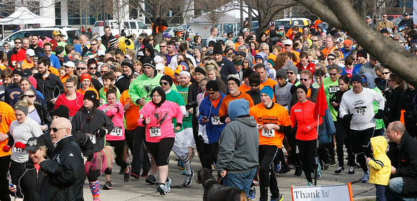 Candace H. Johnson Runners take off during The Human Race, a 5K walk/run supporting McHenry County charities on Corporate Drive in McHenry.