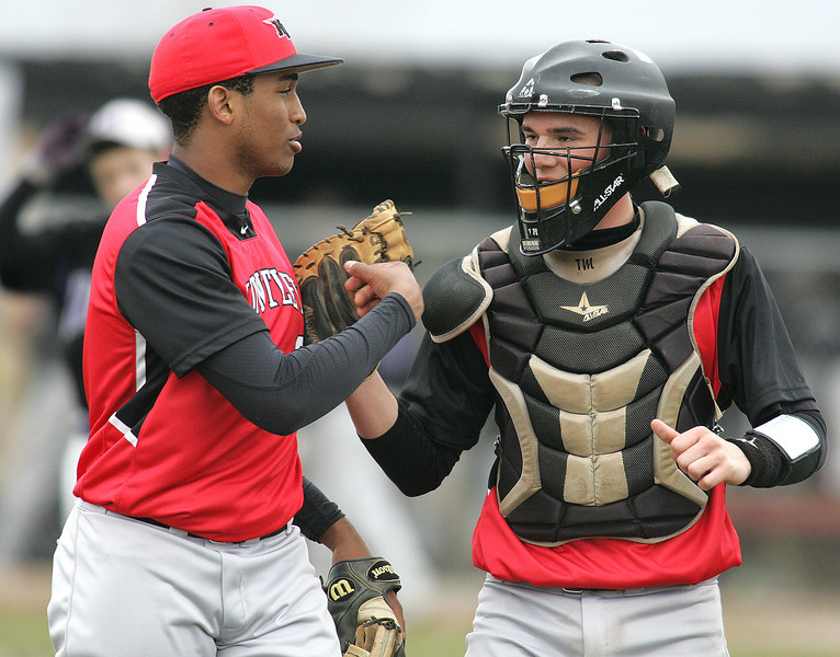 H. Rick Bamman - hbamman@shawmedia.com Huntley's starting pitcher Bryce Only and catcher Andy Kalas celebrate a Hampshire strike out for the third out in the third inning Tuesday, April 9, 2013.