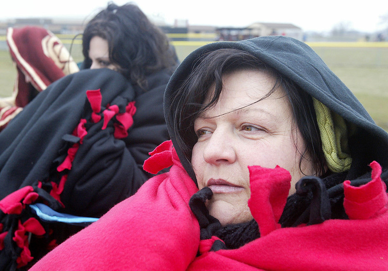 H. Rick Bamman - hbamman@shawmedia.com Huntley baseball fans Georgia Kiriakopoulos (left) and Gabrielle Kalish, moms to Tommy and Adam respectivley huddle under blankets to fend of the cold while watchhing play between Huntley and Hampshire. For details on Huntley's 10-0 win turn to sports.