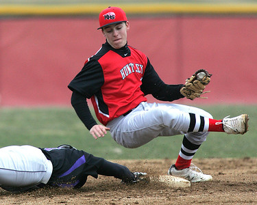H. Rick Bamman - hbamman@shawmedia.com Hampshire's Piotr Barnas slides safely back to second as Huntley's Mat Sullivan tries to make the tag in the third inning Tuesday, April 9, 2013. Huntley won 10-1.