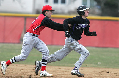 H. Rick Bamman - hbamman@shawmedia.com Huntley's Matt Sullivan puts the tag on Hampshire's Brandon Bowen after he was caught in a rundown in the third inning Tuesday, April 9, 2013. Huntley won 10-0.
