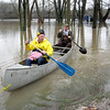 Ryan Klauss of Valley View gets a canoe ride from Rick Paske of Hoffman Estates to his grandmother's house on Tuscola Avenue in the Valley View subdivision of St. Charles Township on Thursday. The area of Tuscola and Lincoln Street to Pakan Drive and Taly Park was flooded when the Fox River overflowed its banks from recent rains. About a dozen houses and an apartment building in the area were flooded and impassable except by canoe, Klauss said. (Brenda Schory photo)