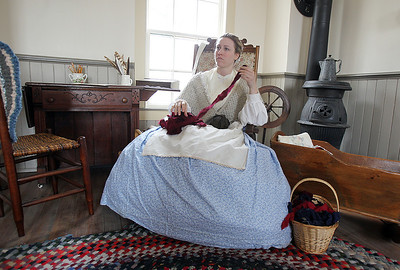 Sarah Nader - snader@shawmedia.com Jessica Jacoby of Cary re-enacts Jane Powers during the McHenry County Conservation District's Living History Open House at Glacial Park's Powers-Walker House in Ringwood on Saturday, April 6, 2013. Costumed re-enactors demonstrated sessional activities and skills that were done in the 1850's.