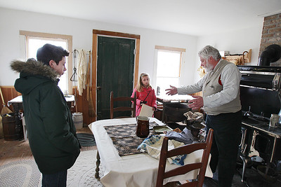 Sarah Nader - snader@shawmedia.com A.J. Georgi, 12, of Hebron and his sister, Melanie, 10, listen to re-enactor Gus  Weinreis of Round Lake explain how a 1850's oven worked during the McHenry County Conservation District's Living History Open House at Glacial Park's Powers-Walker House in Ringwood on Saturday, April 6, 2013. Costumed re-enactors demonstrated sessional activities and skills that were done in the 1850's.