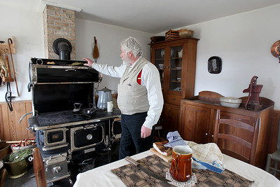 Sarah Nader - snader@shawmedia.com Re-enactor Gus Weinreis of Round Lake explains how a 1850's oven worked during the McHenry County Conservation District's Living History Open House at Glacial Park's Powers-Walker House in Ringwood on Saturday, April 6, 2013. Costumed re-enactors demonstrated sessional activities and skills that were done in the 1850's.