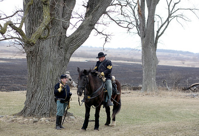 Sarah Nader - snader@shawmedia.com Re-enactor Steve Plattetee (left) of Janesville, WI. and Ward Brown of Richmond go back in time to the1850's during the McHenry County Conservation District's Living History Open House at Glacial Park's Powers-Walker House in Ringwood on Saturday, April 6, 2013. Costumed re-enactors demonstrated sessional activities and skills that were done in the 1850's.