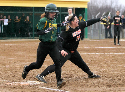 Monica Maschak - mmaschak@shawmedia.com   Crystal Lake South's Erin Yazel makes it to first base before McHenry's Kelsea Cichocki can tag her out during a rainy match between McHenry and Crystal Lake South on Monday, April 15, 2013.  McHenry won 8-1 when officials called the game after the fifth inning.