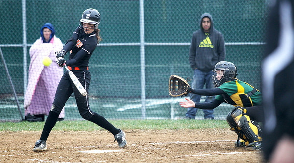 Monica Maschak - mmaschak@shawmedia.com   McHenry's Alex Martens hits the ball during a rainy match between McHenry and Crystal Lake South on Monday, April 15, 2013.  McHenry won 8-1 when officials called the game after the fifth inning.
