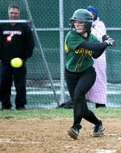 Monica Maschak - mmaschak@shawmedia.com   Crystal Lake South's Erin Yazel about to swing for the ball during a rainy match against McHenry on Monday, April 15, 2013.  McHenry won 8-1 when officials called the game after the fifth inning.