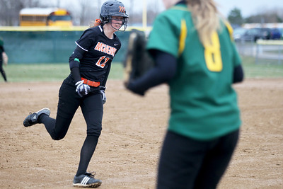 Monica Maschak - mmaschak@shawmedia.com   McHenry's Katelyn Sena rounds off third base during a rainy match between McHenry and Crystal Lake South on Monday, April 15, 2013.  McHenry won 8-1 when officials called the game after the fifth inning.