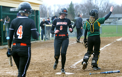 Monica Maschak - mmaschak@shawmedia.com   McHenry's Kristin Koepke scores a run during a rainy match at Crystal Lake South on Monday, April 15, 2013.  McHenry won 8-1 when officials called the game after the fifth inning.