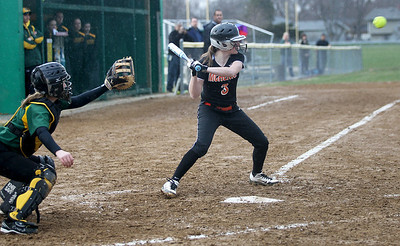 Monica Maschak - mmaschak@shawmedia.com   McHenry's Carly Mattson prepares for the ball during a rainy match at Crystal Lake South on Monday, April 15, 2013.  McHenry won 8-1 when officials called the game after the fifth inning.