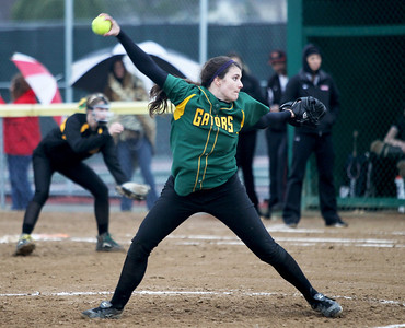 Monica Maschak - mmaschak@shawmedia.com   Crystal Lake South's Crystal Massie throws a pitch during a rainy match against McHenry on Monday, April 15, 2013.  McHenry won 8-1 when officials called the game after the fifth inning.