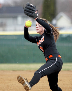 Monica Maschak - mmaschak@shawmedia.com   McHenry's Kristin Koepke throws a pitch during a rainy match at Crystal Lake South on Monday, April 15, 2013.  McHenry won 8-1 when officials called the game after the fifth inning.