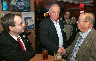 H. Rick Bamman - hbamman@shawmedia.com McHenry County College Board of Trustees candidate Thomas Wilbeck (center) of Lakewood speaks with supperters Demetri Tsilimigras (left) and Tom McDermott at Kelly's Cuckoo Nest in Cary.
