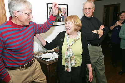 "H. Rick Bamman - hbamman@shawmedia.com McHenry County College Board of Trustees candidate Molly Walsh reacts with her husband Bob upon hearing election results Tuesday night in her Crystal Lake home. Campaign supporter Ed Bennett looks on at right.  Walsh said she was ""humbled"" by the community's response to he campaign. She received the most votes with 13,239."