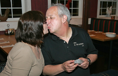 H. Rick Bamman - hbamman@shawmedia.com Grafton Township Assessor candidate Alan Zielinski and Michealene George share a celebratory kiss after hearing election results at Lou Malnati's in Lakewood Tuesday night.