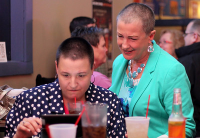 Sarah Nader - snader@shawmedia.com McHenry Mayor Sue Low (right) and her daughter, Bethany Murgatroyed monitors the returns at Low's election party at The Gambler in McHenry on Tuesday, April 9, 2013. With all 23 precincts reporting but provisional and late absentee ballots still to be counted, Low received 1,980 votes to Steven Cuda's 1,546, a 56 to 44 percent margin.