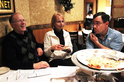 Monica Maschak - mmaschak@shawmedia.com  Cary mayoral candidate Bruce Kaplan and his wife Debbie Kaplan listen to results received by Peter Spizzirri at Galati's Pizza and Pasta in Cary on election night Tuesday, April 9, 2013. Kaplan lost the race 1450 - 1305 against Kownick.