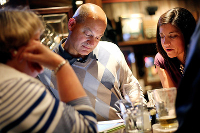 Sarah Nader - snader@shawmedia.com With all 23 precincts reported former mayor Steve Cuda (center) looks at the numbers during an election party at the Village Squire in McHenry on Tuesday, April 9, 2013. Cuda lost the race to McHenry Mayor Sue Low, with a 56 to 44 percent margin.