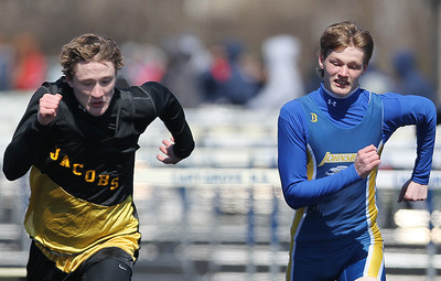 Sarah Nader - snader@shawmedia.com Jacobs' McLain Camden (left) and Johnsburg's Sam Blankenship race while competing in the 110m high hurdles  during Saturday's McHenry County Track Meet at Cary-Grove High School on April 20, 2013.