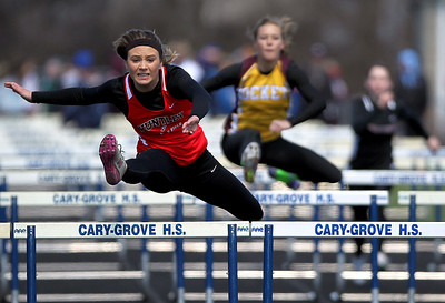 Sarah Nader - snader@shawmedia.com Huntley's Macy Tramblay competes in the 100m hurdles semi-finals during Saturday's McHenry County Track Meet at Cary-Grove High School on April 20, 2013.